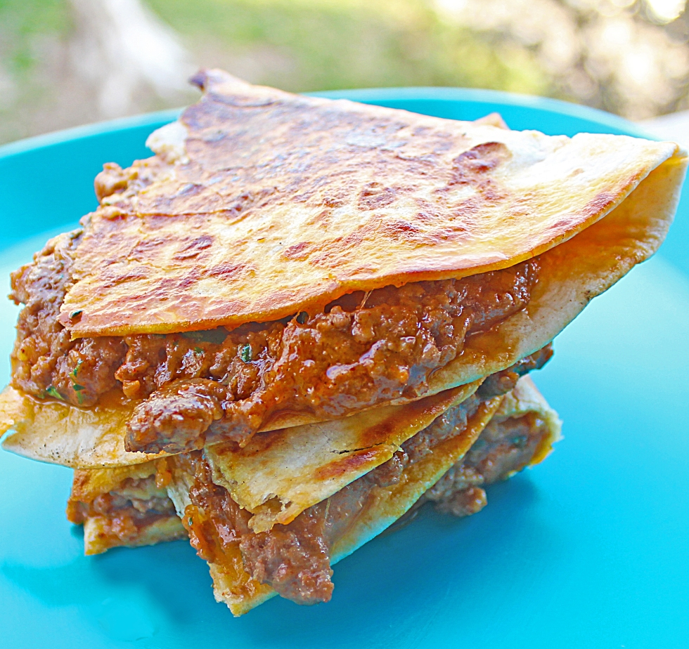 This spicy hamburger quesadilla can be ready in less than 15 minutes. It's a perfect blend of hot and savory spices.